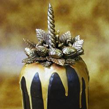An example of a Christmas confectionery composition with a candle in chocolate on an iced panettone