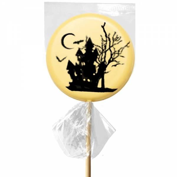 La casa delle streghe di Halloween raffigurata sul lecca lecca di cioccolato bianco.