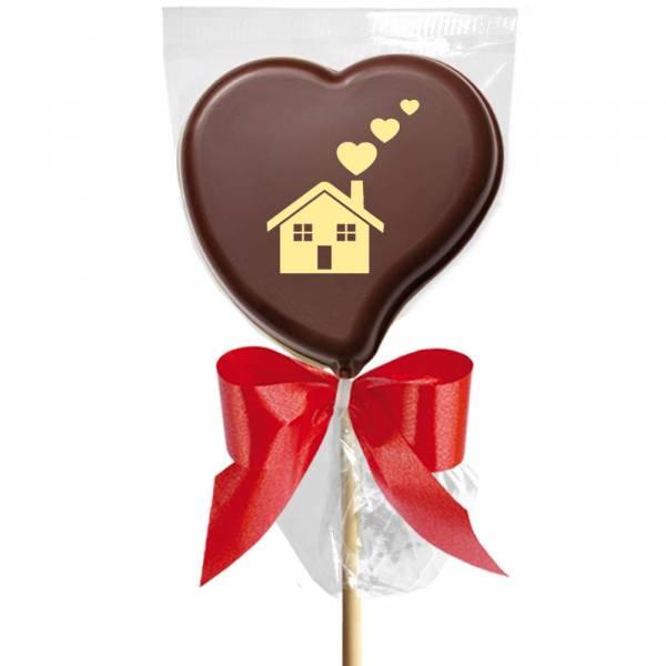 Una casetta manda segnali di fumo fatti a cuore è un inconfondibile MSG d'amore se stampato su un lecca lecca di cioccolato.  ,