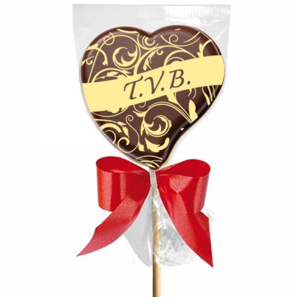 """""""TVB"""" è il tipico MSG  da cellulare, ma questa volta dichiaralo su un o quisito lecca lecca di cioccolato."""