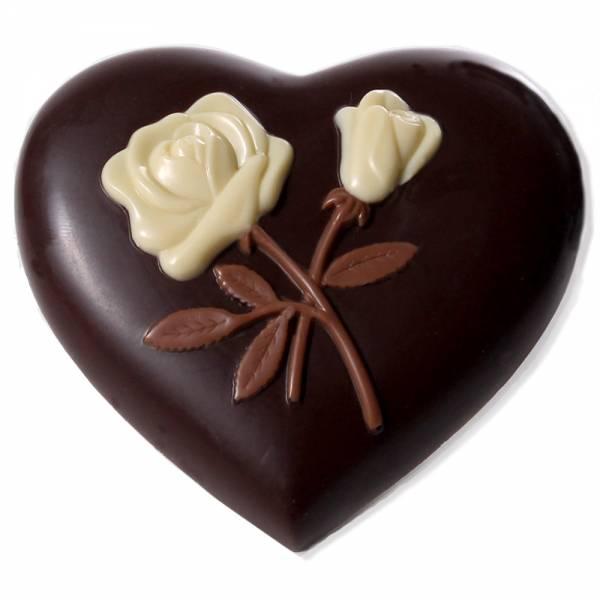 Cuore di cioccolato fondente con rose in rilievo