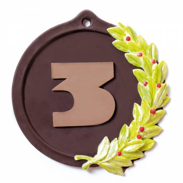 Medaglie di cioccolato non solo per il podio ma personalizzabili con scritte opportune.